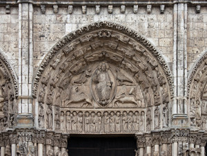 """Central tympanum of the Royal portal, Chatres Cathedral, 1145-50. The """"Majestas Domini"""" in the typmanum of the Main potral of the Chartres Cathedral is usually called a """"Last judgement"""" as the symbols of the four evangelists are often interpreted as the four beasts of the apocalyse although the title would be more obvious if the Lord was seated on a rainbow as mentioed in Old Testament phrofit's vision."""